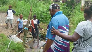 Community members in Solomon Islands showing enabling actors the WASH conditions within their settlement. Photo: Semisi Meo